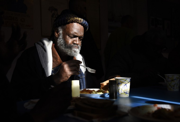 John Harrison of Baltimore eats lunch at Viva House, a West Baltimore soup kitchen. (Barbara Haddock Taylor/Baltimore Sun)