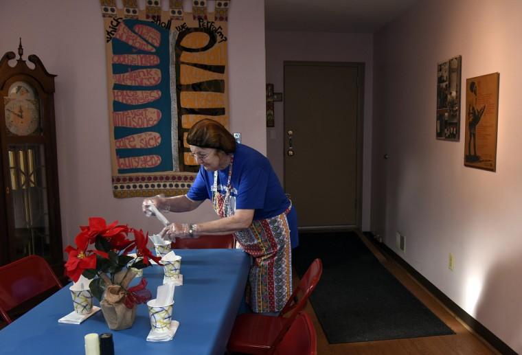 Carol Rosen of Bowie places packages of cookies on a table in one of the dining rooms at Viva House.  She has volunteered at Viva House for around 10 years, baking several hundred cookies a week and serving the guests.  (Barbara Haddock Taylor/Baltimore Sun)