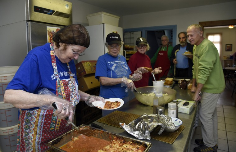 Left to right: Volunteers Carol Rosen of Bowie, Nancy Connell of Severna Park, Willa Bickham of Baltimore, Pete Naughton of Baltimore, Steve Strausbaugh of Baltimore, Mike Chovonec of Baltimore.  Volunteers work in the kitchen to get ready to serve guests at Viva House, a West Baltimore soup kitchen. Today's meal of lasagna was prepared by chefs from Gertrude's Restaurant at the Baltimore Museum of Art. (Barbara Haddock Taylor/Baltimore Sun)