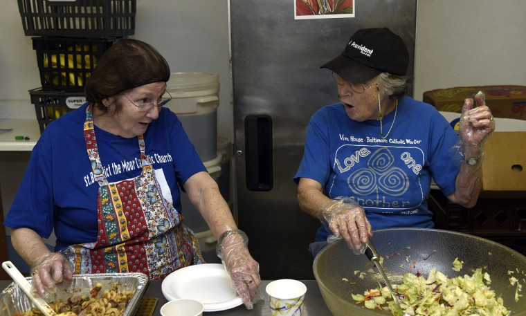 Volunteers Carol Rosen of Bowie, left, and Nancy Connell of Severna Park, right, sing a sea shanty as they work in the kitchen at Viva House, a West Baltimore soup kitchen that was founded 49 years ago by Catholic Worker husband and wife team Brendan Walsh and Willa Bickham. Ms. Rosen bakes several hundred cookies per week to give to guests at Viva House.  (Barbara Haddock Taylor/Baltimore Sun)