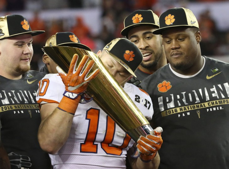 Clemson Tigers linebacker Ben Boulware (10) kisses the championship trophy after the College Football Playoff National Championship on Monday Jan. 9, 2017 at Raymond James Stadium, in Tampa, Fla. Clemson Tigers defeated the Alabama Crimson Tide 35 to 31. (Monica Herndon /Tampa Bay Times/TNS)