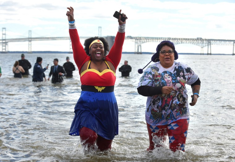 Lashawn Johnson and Kathy Blue of the Montgomery County ERT emerge from the water during the 21st Annual Maryland State Police Polar Bear Plunge.  (Lloyd Fox/Baltimore Sun)