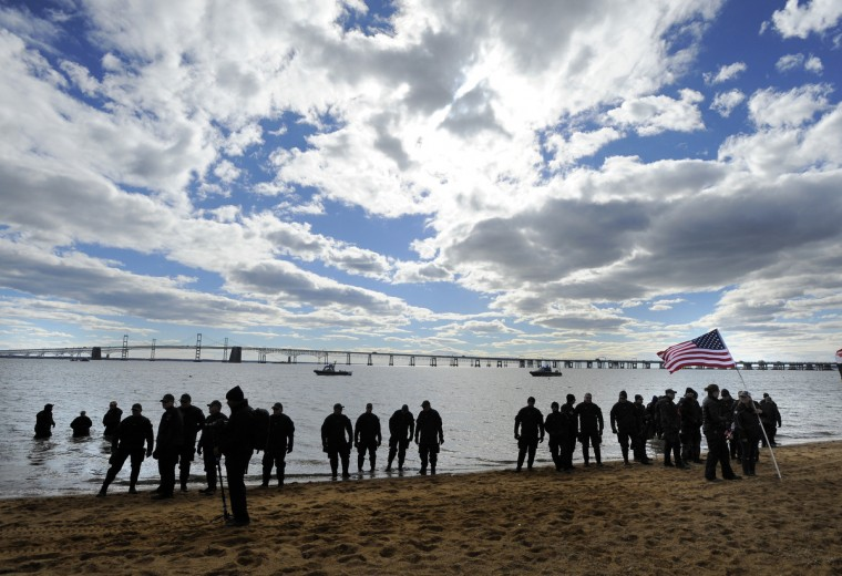 Police officers get ready to head into the water before the plungers make begin the 21st Annual Maryland State Police Polar Bear Plunge and PlungeFest.  (Lloyd Fox/Baltimore Sun)