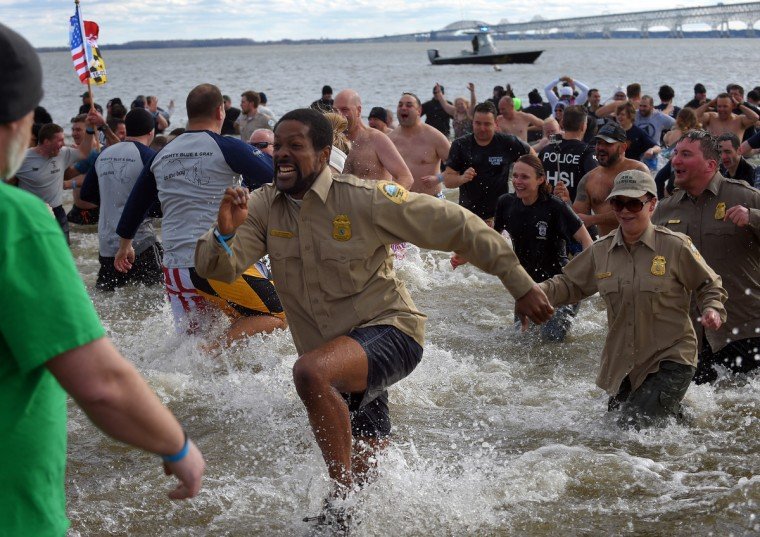 Plungers emerge from the water during the 21st Annual Maryland State Police Polar Bear Plunge.  (Lloyd Fox/Baltimore Sun)