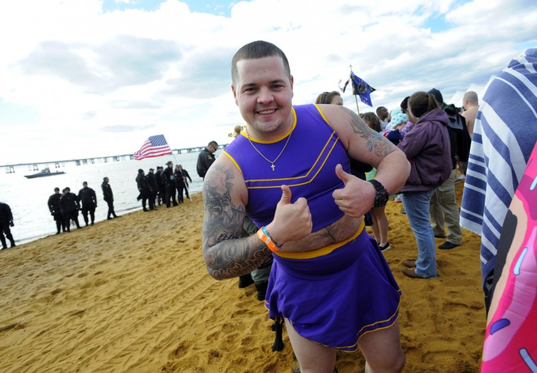 Officer Justin Bell with the MTA Police gets ready for his plunge. (Lloyd Fox/Baltimore Sun)
