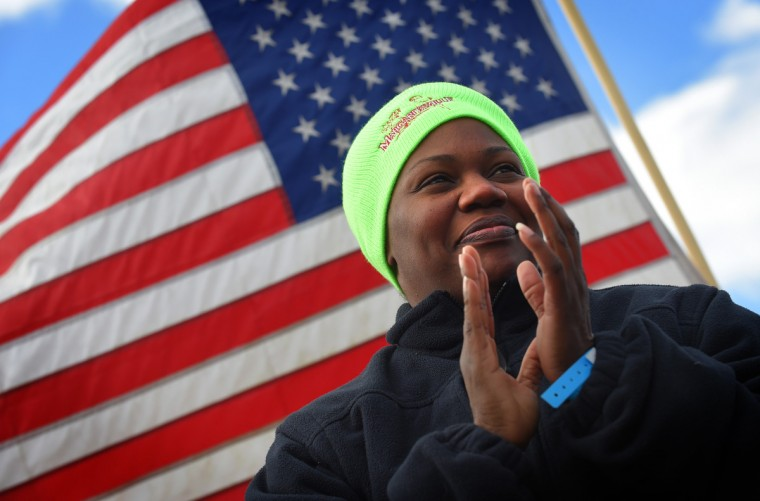 Melita Jefferson, a community policing officer with the Fort Meade Police, waits for the start of the 21st Annual Maryland State Police Polar Bear Plunge.  (Lloyd Fox/Baltimore Sun)
