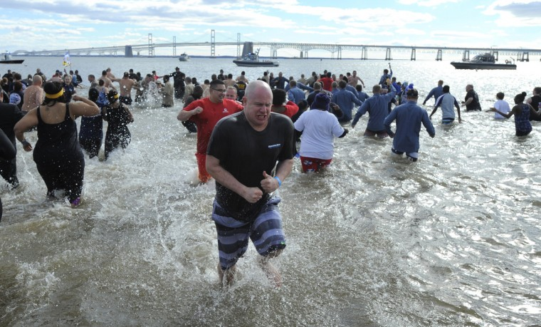 Hundreds of police officers and members of the various departments head into the water for the 21st Annual Maryland State Police Polar Bear Plunge and PlungeFest held at Sandy Point State Park.  (Lloyd Fox/Baltimore Sun)