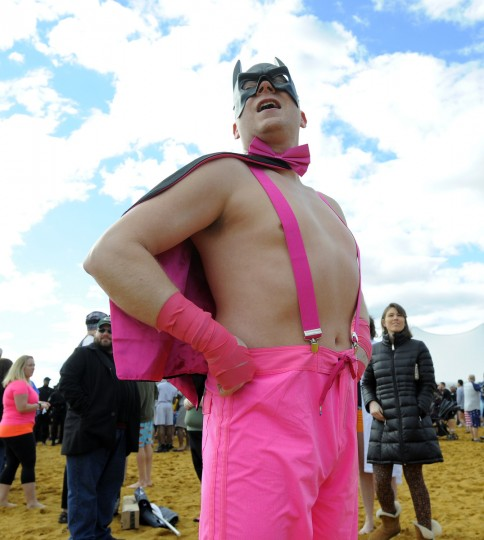 Cpl. Mike Lorng of the Salisbury Police Department is seen at the Maryland State Police Polar Bear Plunge and PlungeFest held at Sandy Point State Park.  (Lloyd Fox/Baltimore Sun)