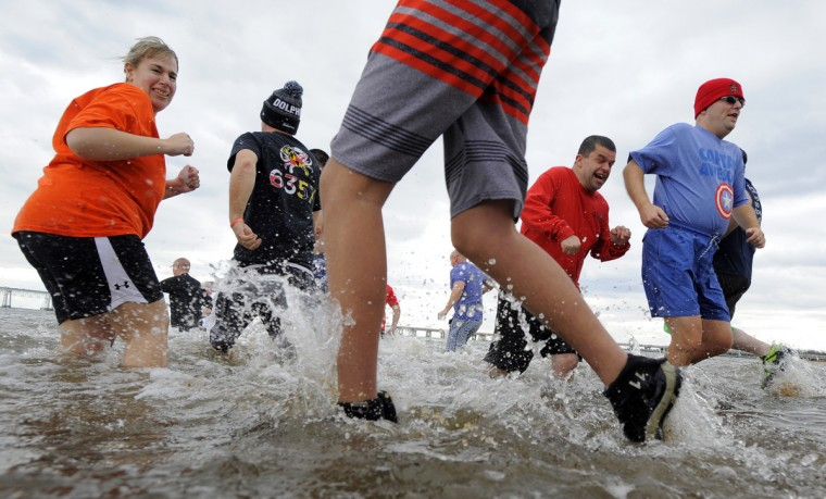 Plungers enter the water during the 21st Annual Maryland State Police Polar Bear Plunge and PlungeFest. (Lloyd Fox/Baltimore Sun)