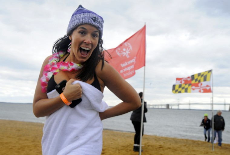 Mary Kokosko of Annapolis warms up after getting out of the water.  (Lloyd Fox/Baltimore Sun)