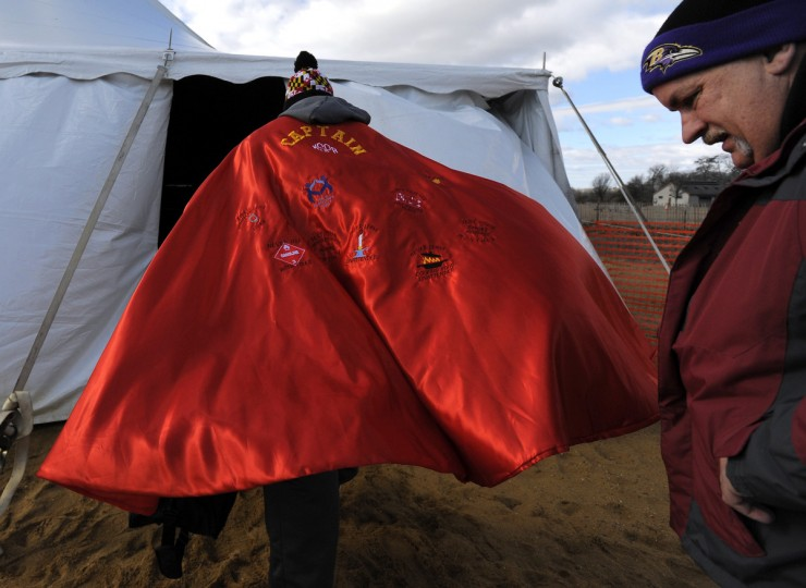 Bruce Bouch of Gamber (L) with the Maryland State Fireman's  Association and Shawn Chenowith of Gamber head to the tent to get ready for their plunge. (Lloyd Fox/Baltimore Sun)