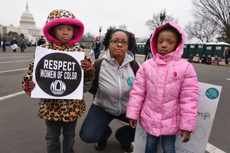 "Chenita Farmer, 36, brought her nieces Kezia and Imani Temateu, ages 6 and 4, to the Women's March on Washington. Farmer said about her nieces: ""I want them to have a future, to be able to go to the doctor and not have to worry about it."" (Amy Davis/Baltimore Sun)"
