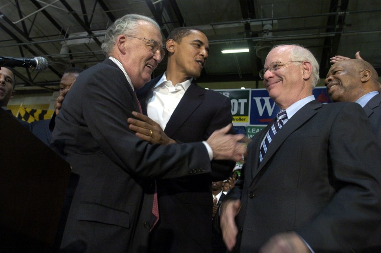 November 03, 2006 -- Retiring Sen. Paul Sarbanes hugs Illinois Sen. Barack Obama after speaking glowingly about Cong. Ben Cardin, the man he supports to take his seat. They are attending a Democrat rally in a gym at  Bowie State University with many other state leaders. (Kim Hairston/Baltimore Sun)