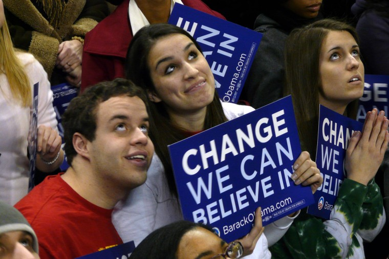 February 11, 2008 -- College Park students Brad Nole and Jackie Phillips (center) watch a video of Sen. Barack Obama,  while waiting for the U.S. Senator to address them during a campaign stop at University of Maryland's College Park campus.  (Karl Merton Ferron/Baltimore Sun)
