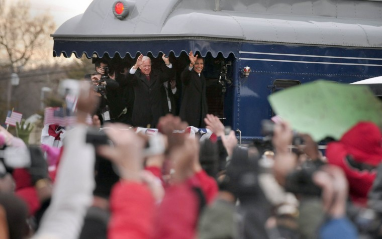 January 17, 2009 -- Vice President-elect Joe Bidden and President-Elect Barack Obama wave to their supporters from the back of the train as they make a slow roll past the Edgewood MARC station. (Kim Hairston/Baltimore Sun)