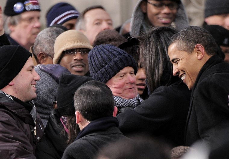 January 17, 2009 -- President-elect Barack Obama greets the  crowd including Baltimore County Executive Jim Smith (center)at the War Memorial Plaza during his whistle stop train trip. (Monica Lopossay/Baltimore Sun)