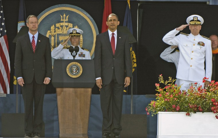 May 22, 2009 -- Maryland Gov. Martin O'Malley (l-r), Captain Matthew Klunder, Commandant of Midshipmen, President Barak Obama and Vice Admiral Jeffrey Fowler, Superintendent of the Naval Academy, stand for the National Anthem at the start of the ceremonies. President Barak Obama gave the graduation address at the United States Naval Academy Class of 2009 Graduation and Commissioning Ceremonies. (Kenneth K. Lam/The Baltimore Sun)