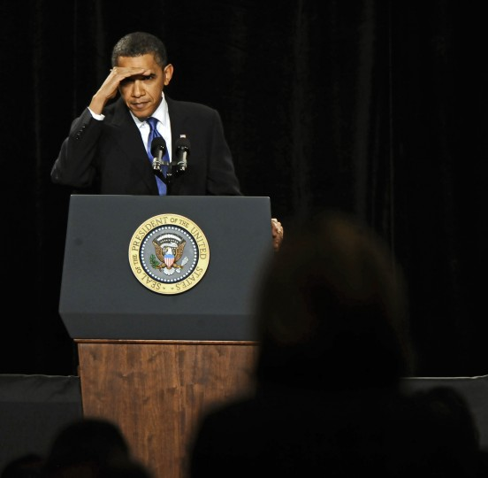 January 29, 2010 --  President Barack Obama shields his eye from the stage lights as he listens to a question from Republican House member during their retreat held at the Renaissance Baltimore Harborplace Hotel. (Kenneth K. Lam/The Baltimore Sun)