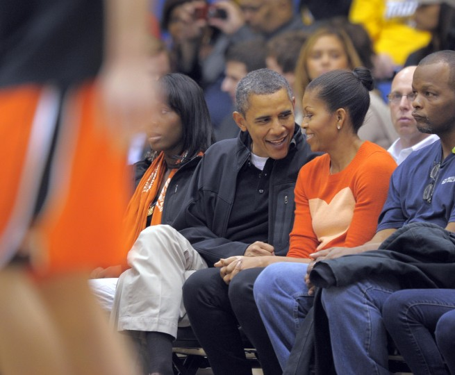 November 26, 2011 -- President Barack Obama and the First Lady, Michelle Obama watch pre-game warmups as the Towson Tigers host the Oregon State Beavers in the men's college basketball home opener at the Towson Center. (Karl Merton Ferron/Baltimore Sun)
