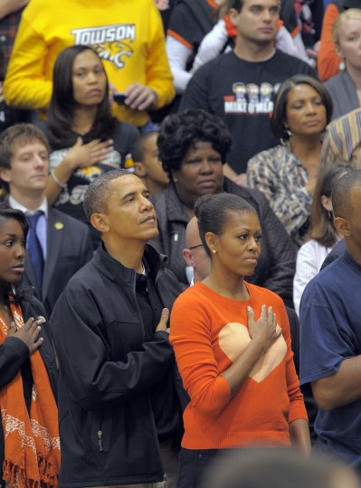 November 26, 2011 -- President Barack Obama and the First Lady, Michelle Obama stand for the playing of the Star Spangled Banner as the Towson Tigers host the Oregon State Beavers in the men's college basketball home opener at the Towson Center. (Karl Merton Ferron/Baltimore Sun)