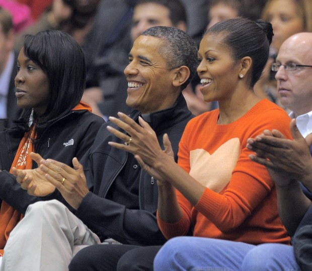 November 26, 2011 -- President Barack Obama and the First Lady, Michelle Obama applaud for Oregon State Beavers head coach Craig Robinson as the Towson Tigers host the Oregon State Beavers in the men's college basketball home opener at the Towson Center. (Karl Merton Ferron/Baltimore Sun)