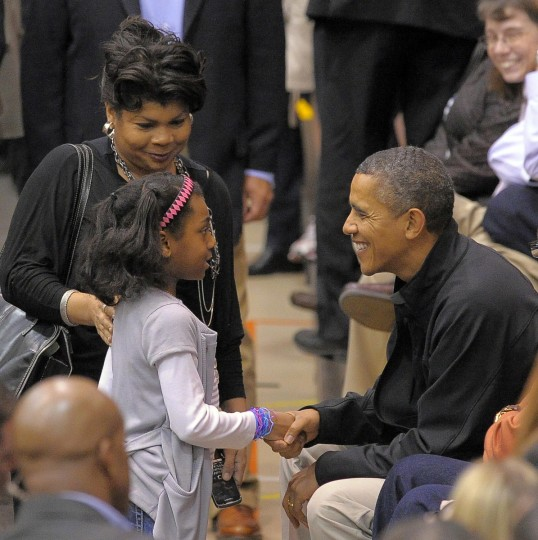 November 26, 2011 -- President Barack Obama chats with American Urban Radio Networks' April Ryan of Baltimore County (cell: 202-285-3557) and meets her daughter Ryan James, 9 as the Towson Tigers host the Oregon State Beavers in the men's college basketball home opener at the Towson Center. (Karl Merton Ferron/Baltimore Sun)