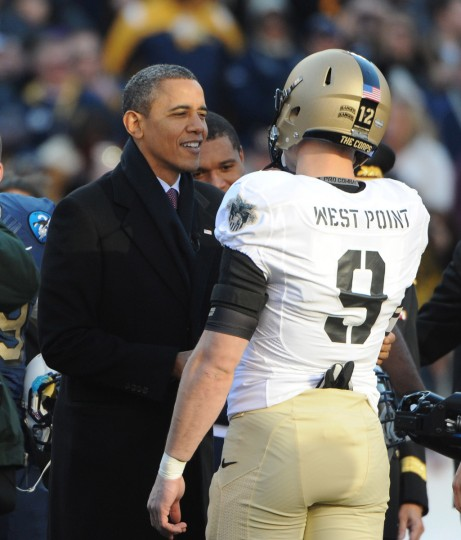 December 10 2011-- President Barak Obama shakes hand with Army's Steven Erzinger before conducting the coin tossfor the 2011 Army Navy game. (Kenneth K. Lam/The Baltimore Sun)