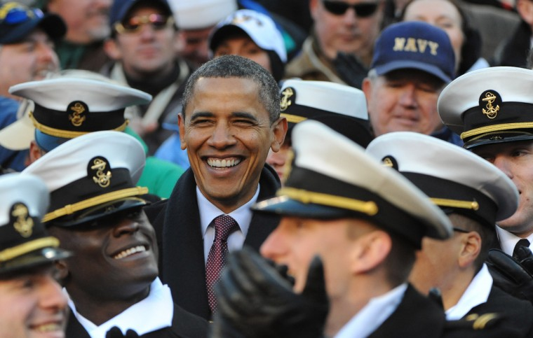 Landover, Md.--12/10/11-- President Barak Obama jokes and laughs with midshipmen during the 2011 Army Navy game. (Kenneth K. Lam/The Baltimore Sun)