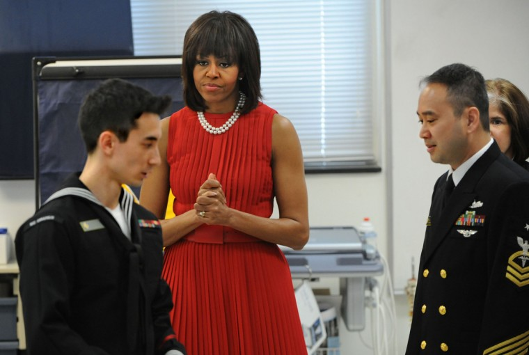 April 17, 2013 -- First Lady Michelle Obama tours the orthopedic room at the U.S. Naval Academy with sailors HM3 Matthew Potter, left, HMCS Danilo Salazar, right, and (partially blocked behind Salazar) HM2 Jennifer Lee. They will be affected by the Veterans Full Employment Act of 2013. After the visit to the U.S Naval Academy, the First Lady visited the  Maryland State House for the bill signing. (Amy Davis/Baltimore Sun)