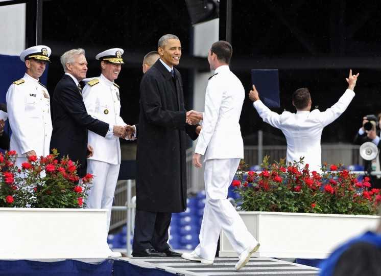 May 24, 2013 -- President Barak Obama, center, the key note speaker during the 163rd traditional U.S. Naval Academy commissioning and graduation ceremony, shakes hand with graduates during ceremony at the Navy-Marine Corps Memorial Stadium. (Kenneth K. Lam/The Baltimore Sun)