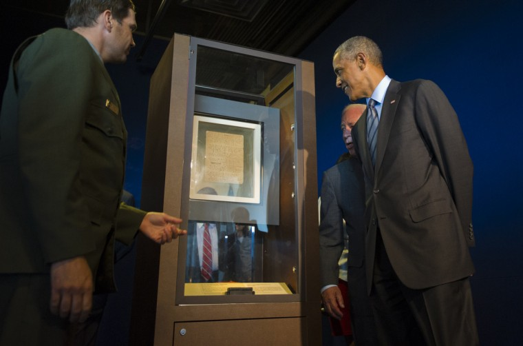 September 12, 2014 --  NPS ranger Vincent Vaise (left) approaches the original document of the Star-Spangled Banner, penned by Francis Scott Key, with Pres. Barack Obama and Burt Kummerow, President and CEO of the Maryland Historical Society (back right) at Fort McHenry. (Karl Merton Ferron/Baltimore Sun)
