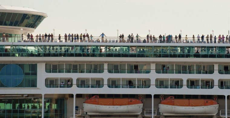 September 12, 2014 --  People aboard a cruise ship watch from the deck as the motorcade races up to I-95 toward Pikesville during a visit of the president to the city and Fort McHenry. (Karl Merton Ferron/Baltimore Sun)