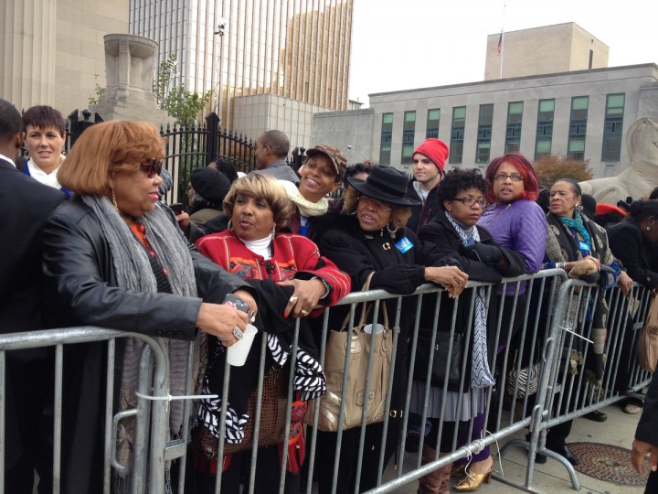 November 3, 2014 -- Crowds, including from left, Elaine Simon 69; Joyce Sanders, 71; Samantha Potts, 31, & Maxine Webb, 62, wait in line in front of the War Memorial for Michelle Obama & Anthony Brown on the last day of the campaign. (Algerina Perna/Baltimore Sun)