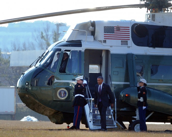 January 15, 2015 -- President Barack Obama deplanes Marine One at Port Covington during a visit to Charmington's Cafe where he ate lunch with three Baltimore women to discuss the needs of all Americans as they balance their families and jobs. (Kenneth K. Lam/The Baltimore Sun)
