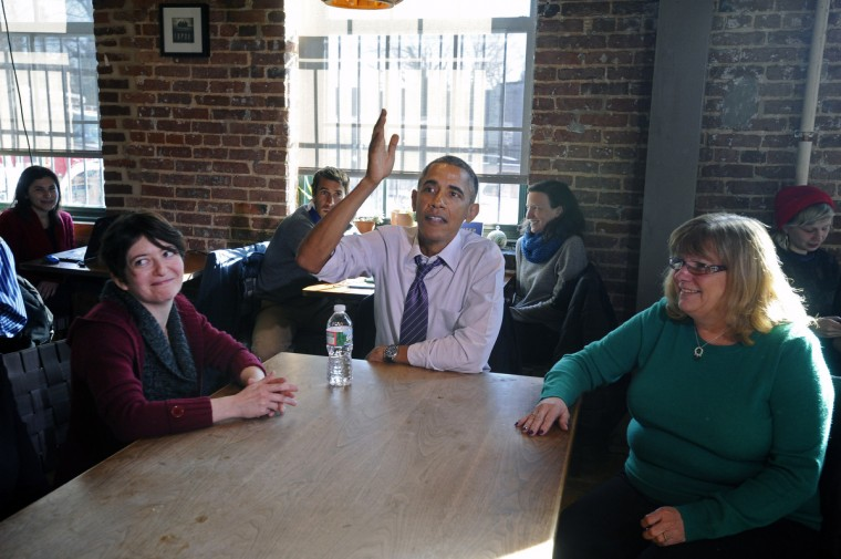 January 15, 2015 -- President Barack Obama, center, ate lunch with Amanda Rothschild, left, Mary Stein, right, and another woman, not pictured, at Charmington's Cafe in Baltimore, to discuss the needs of all Americans as they balance their families and jobs. (Kenneth K. Lam/The Baltimore Sun)
