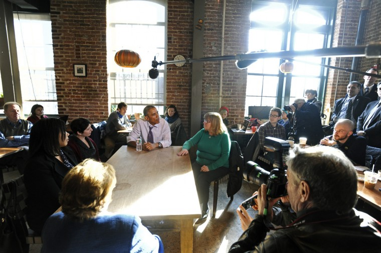 January 15, 2015 -- President Barack Obama, center, and Sen. Barbara Mikulski, left with back to camera, ate lunch at Charmington's Cafe with Vika Jordan, from left, Amanda Rothschild, and Mary Stein, in green seather, to discuss the needs of all Americans as they balance their families and jobs. (Kenneth K. Lam/The Baltimore Sun)