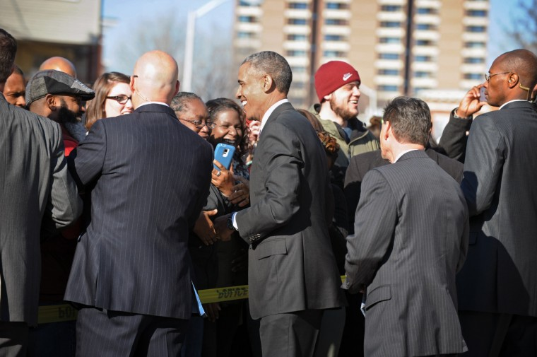 January 15, 2015 -- President Barack Obama, center, shakes hand with onlookers after having lunch at Charmington's Cafe with three Baltimore women to discuss the needs of all Americans as they balance their families and jobs. (Kenneth K. Lam/The Baltimore Sun)