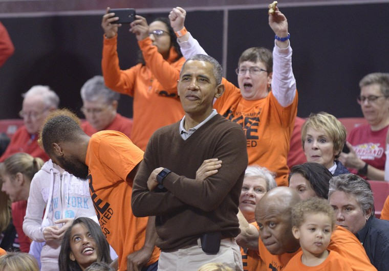 March 21, 2015 -- President Barack Obama, alongside his brother-in-law Craig Robinson, attends a NCAA Division I Women's College Basketball tournament game between Princeton and Green Bay at the XFINITY Center in College Park, Maryland. Princeton forward Leslie Robinson is Obama's niece. (Kevin Richardson/Baltimore Sun)