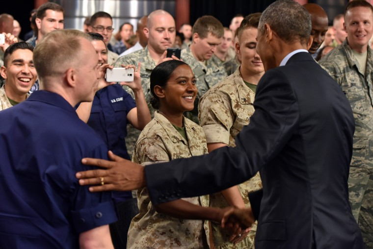 September 11, 2015 -- Left to right,  Senior Chief Petty Officer Michael Hvozda watches as PFC Melanie Bowroth shakes hands with President Barack Obama after a town hall meeting with service members at Fort Meade. Today is the 14th anniversary of the September 11 terrorist attacks. (Kim Hairston/Baltimore Sun)
