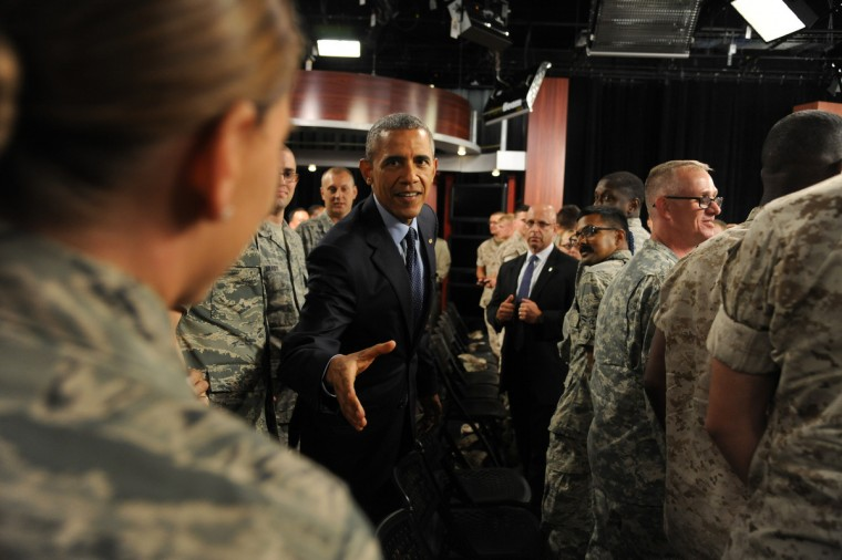 September 11, 2015 -- President Barack Obama shakes hands with service members after attending a militry town hall meeting at Fort Meade on the 14th anniversary of the September 11 terrorist attacks. (Kim Hairston/Baltimore Sun)