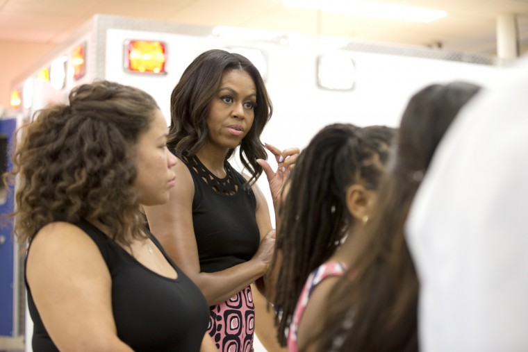 September 17, 2015 -- First Lady Michelle Obama asks a question while she tours Howard Community College in Columbia. (Jen Rynda/Baltimore Sun Media Group)