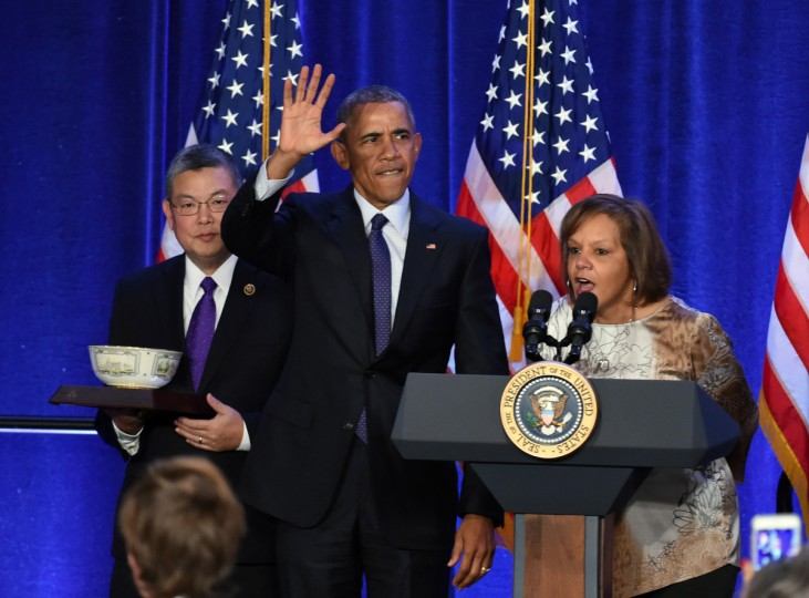 January 28, 2016 --  President Barack Obama, center, waves to the crowd as he is introduced by Rep. Robin Kelly, right, and Rep. Mark Takai during the House Democratic caucus annual retreat at Baltimore's Inner Harbor Hyatt. (Kenneth K. Lam/The Baltimore Sun)
