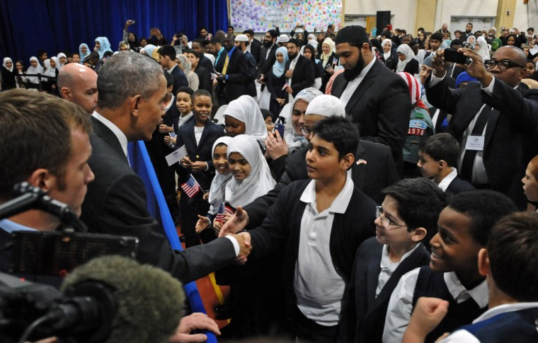 February 3, 2016 -- President Barack Obama, second left, shakes hand with students of the Al-Rahmah School during his visit to the Islamic Society of Baltimore, one of the largest mosques in the region. The President is making his presidency's first visit to a U.S. mosque. (Kenneth K. Lam/The Baltimore Sun)