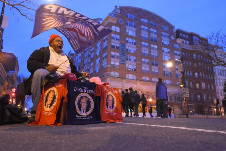 Ira Supreme of California sells shirts and flags early in the morning in Washington prior to the Inauguration of Donald Trump as the 45th President of The United States. (Lloyd Fox/Baltimore Sun)