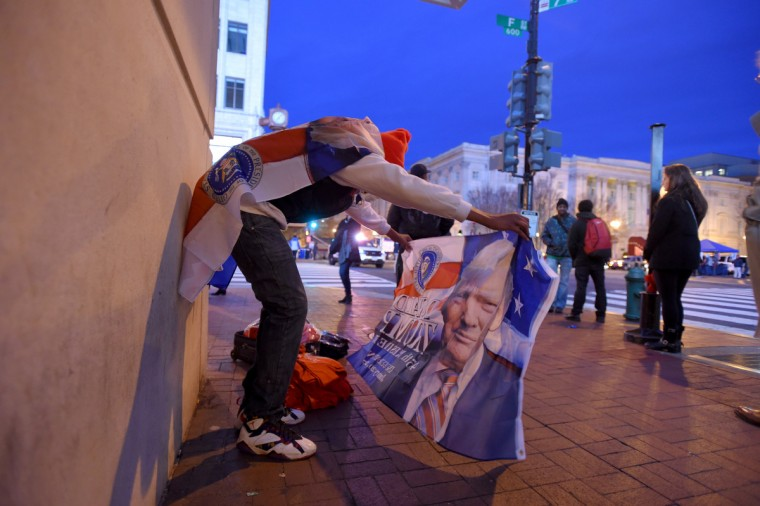 Daniel Nelson of Los Angeles sells shirts and flags  prior to the Inauguration of Donald Trump as the 45th President of The United States. (Lloyd Fox/Baltimore Sun)