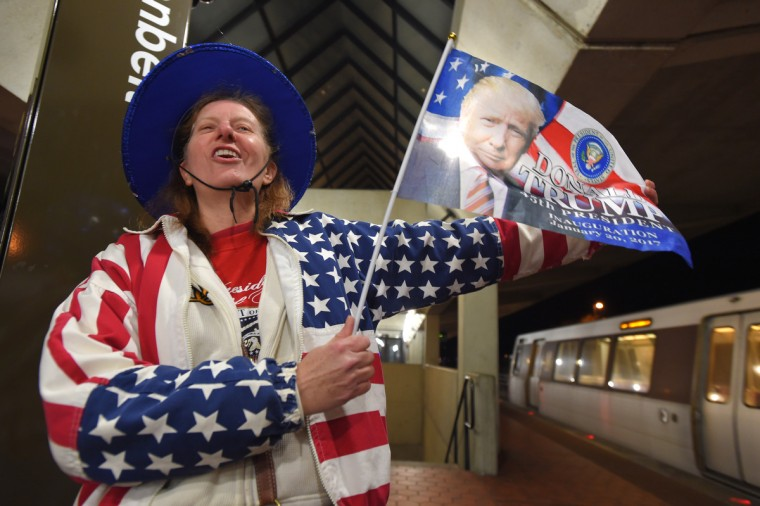 Jamie Bartbarger of Pittsburgh waits for a train at the Greenbelt Station as she makes her way to the inauguration.  (Lloyd Fox/Baltimore Sun)