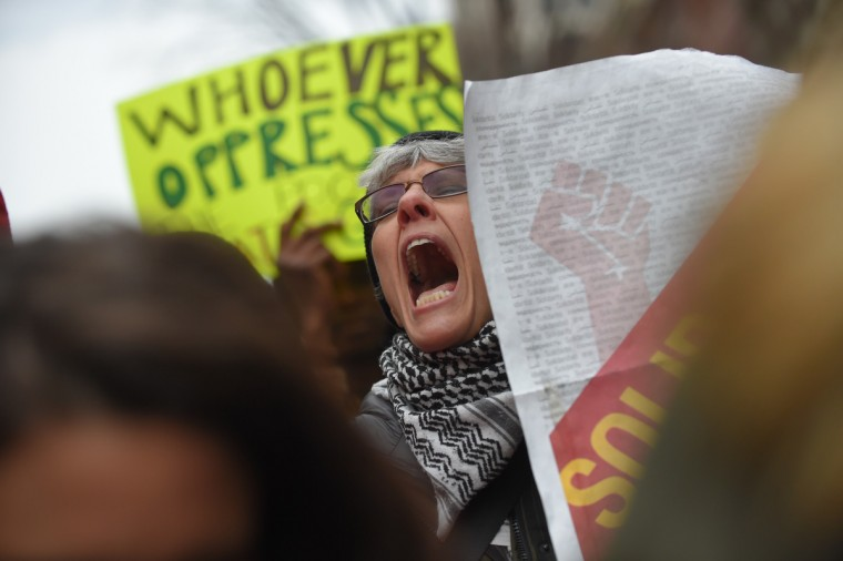 Protesters chant while waiting in line for security prior to the Inauguration of Donald Trump as the 45th President of The United States. (Lloyd Fox/Baltimore Sun)