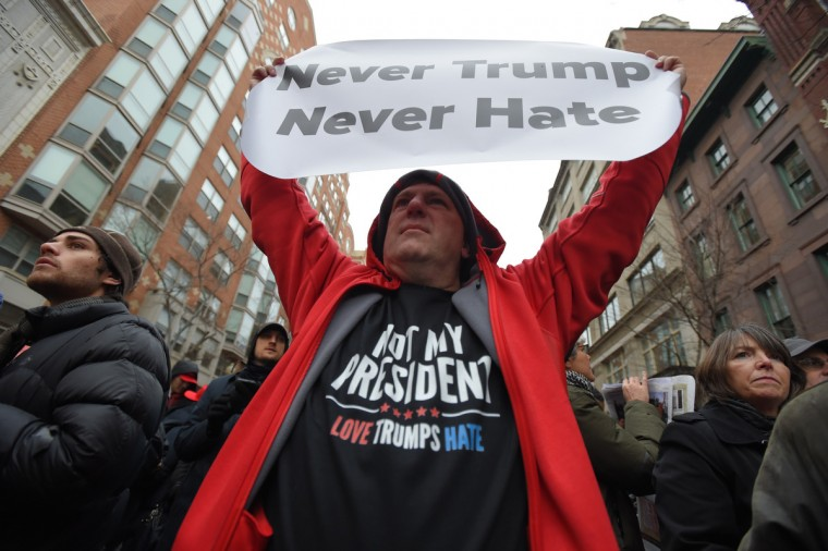 Jeff Bruce of Boston holds a sign while waiting in line for security  prior to the Inauguration of Donald Trump as the 45th President of The United States. (Lloyd Fox/Baltimore Sun)