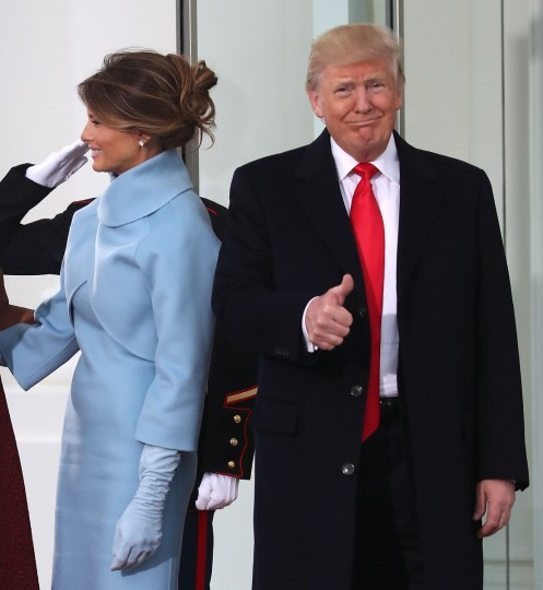 President-elect Donald Trump gives a thumbs up, while he and his wife Melania Trump, are greeted by President Barack Obama and his wife first lady Michelle Obama, upon arriving at the White House on January 20, 2017 in Washington, DC. Later in the morning President-elect Trump will be sworn in as the nation's 45th president during an inaugural ceremony at the U.S. Capitol. (Mark Wilson/Getty Images)