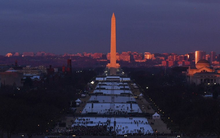 The sun rises at the Washington Monument as people gather on the National Mall on Inauguration Day on January 20, 2017 in Washington, DC. Donald J. Trump will become the 45th president of the United States today.  (Ricky Carioti - Pool/Getty Images)
